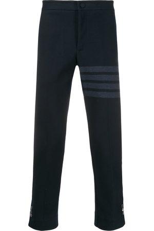 Thom Browne Pantalones slim con 4 rayas