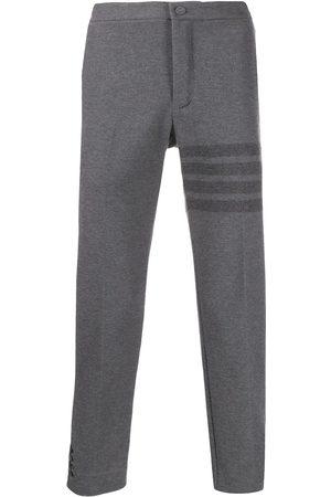 Thom Browne Pantalones a rayas con 4 barras