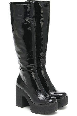 Miu Miu Botas altas de piel con plataforma