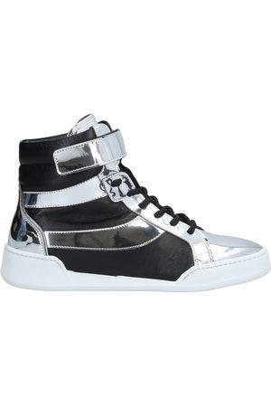 CARLA G. Sneakers abotinadas