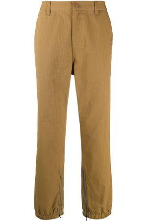 Gucci Pantalones con franjas del logo