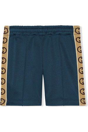 Gucci Pantalones con motivo de G entrelazada
