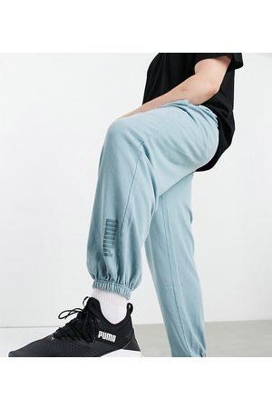PUMA Joggers extragrandes azules desgastados Plus de exclusivo en ASOS