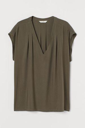H&M Blusa con escote de pico