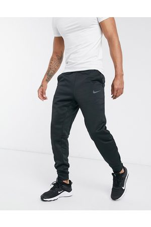 Nike Training Hombre Pantalones slim y skinny - Joggers tapered negros Therma de