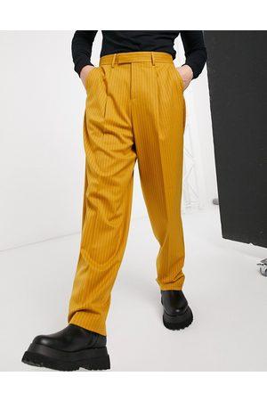 ASOS Pantalones slim elegantes de tiro alto con rayas diplomáticas en color de -Naranja