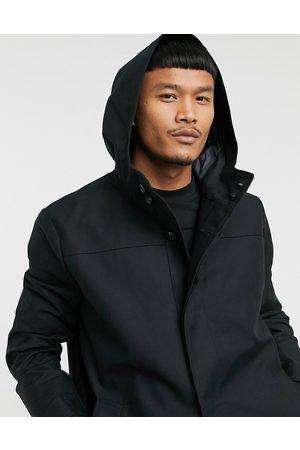 ASOS Gabardina negra con capucha y diseño impermeable de