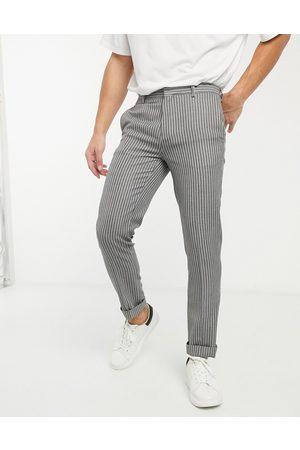 River Island Pantalones de vestir pitillo a rayas de