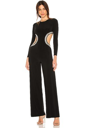Norma Kamali Stud long sleeve cut out jumpsuit en color talla L en - Black. Talla L (también en M, S, XS).