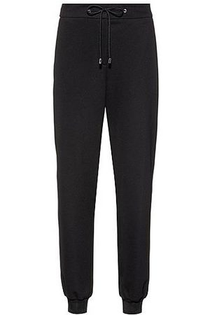 HUGO BOSS Stretch-fabric tracksuit bottoms with logo cuffs