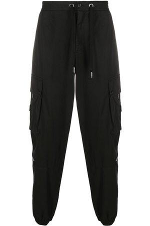 Dolce & Gabbana Pantalones tipo cargo con parche del logo