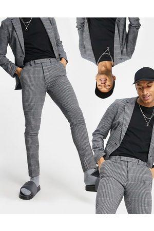 ASOS Pantalones de traje sastre azules pitillo con estampado de cuadros pequeños de estilo cuadrícula de mezcla de lana suave de