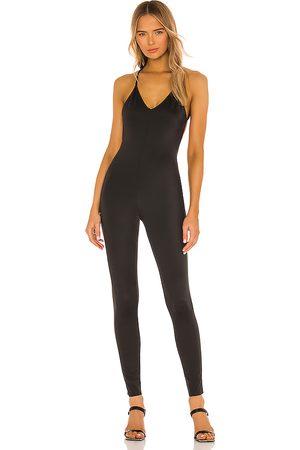 Norma Kamali Low back fara slip catsuit en color talla L en - Black. Talla L (también en M, S, XS).