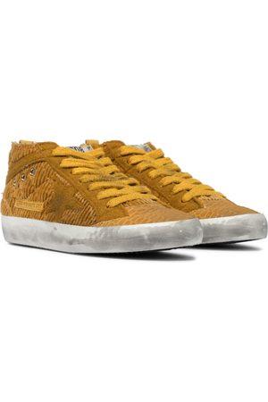 Golden Goose Exclusivo en Mytheresa – zapatillas Midstar de caña alta
