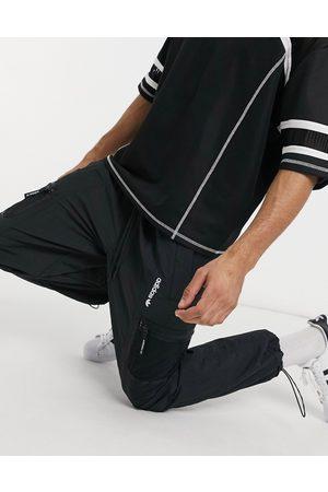 adidas Joggers negros con detalle de bolsillo Adventure de