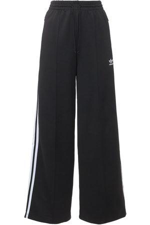 adidas | Mujer Pantalones Relaxed Fit 36