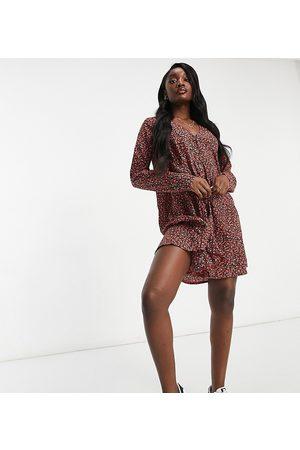 Missguided Vestido amplio de manga larga con estampado floral de