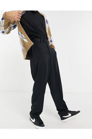 ASOS Pantalones de vestir negros de corte slim y tiro alto de