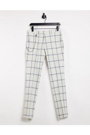 Twisted Tailor Pantalones pitillo blancos con estampado de cuadros ventana y cadena de