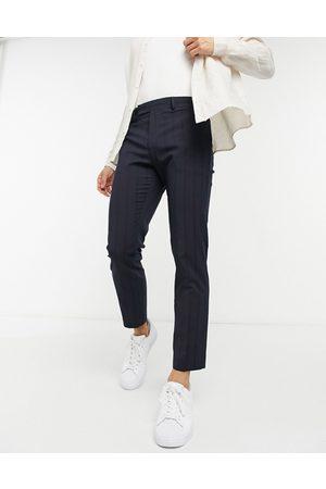 ASOS Pantalones de vestir marino a rayas finas ajustados por encima del tobillo de