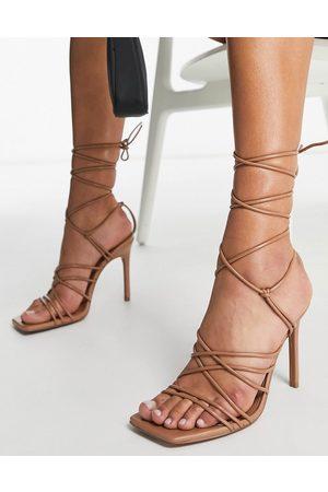 ASOS Sandalias de tacón con diseño de tiras anudadas a la pierna Nina de