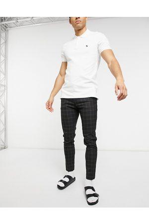 ASOS Pantalones muy ajustados y elegantes a cuadros negros de