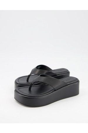 ASOS Sandalias de dedo negras con plataforma plana de cuero premium Target de -Negro