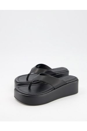 ASOS Sandalias de dedo negras con plataforma plana de cuero premium Target de