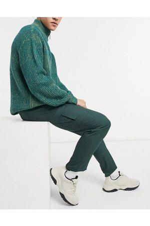 ASOS Pantalones cargo de vestir verde oscuro ajustados de