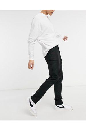 ASOS DESIGN Pantalones de vestir negros cargo de corte pitillo de