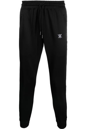 Daily Paper Pantalones de chándal con franjas del logo