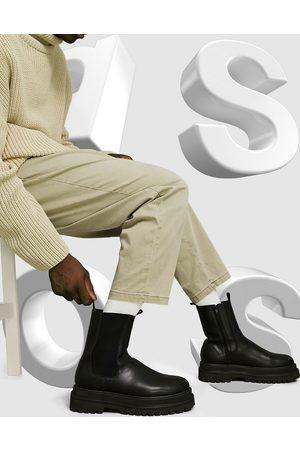 ASOS Botas Chelsea de media caña negras de cuero sintético de