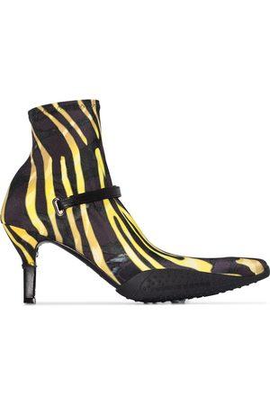 adidas Botines tipo calcetín con estampado de cebra