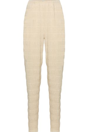 Totême Exclusivo en Mytheresa - pantalones ajustados con motivo nido de abeja de tiro alto