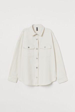 H&M Camisa denim oversize