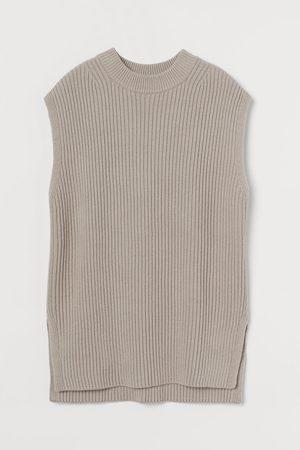 H&M Suéter oversize sin mangas