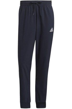 adidas Pantalón chandal Essentials Tapered Cuff 3 Stripes para hombre