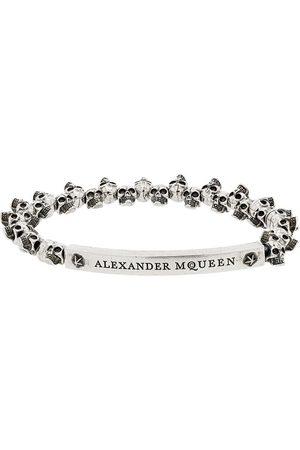 Alexander McQueen Pulsera con calaveras mini