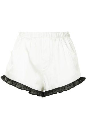 FLEUR DU MAL Shorts con volantes