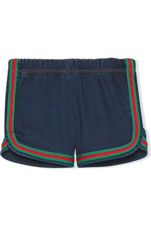 Gucci Pantalones vaqueros cortos con rayas