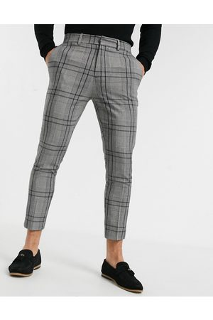 New Look Pantalones capri de vestir con diseño a cuadros grises y corte pitillo de