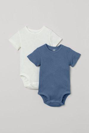 H&M Pack de 2 bodies de algodón