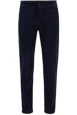 HUGO BOSS Hombre Casual - Pantalones tapered fit en pana de algodón elástico