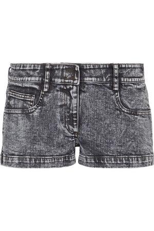 Norma Kamali Shorts de jeans de tiro bajo