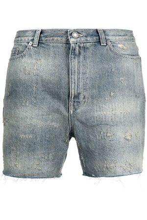 Saint Laurent Hombre Vaqueros - Pantalones vaqueros cortos con efecto envejecido