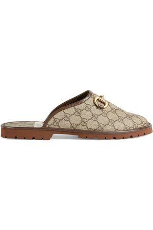Gucci Slippers con monograma GG