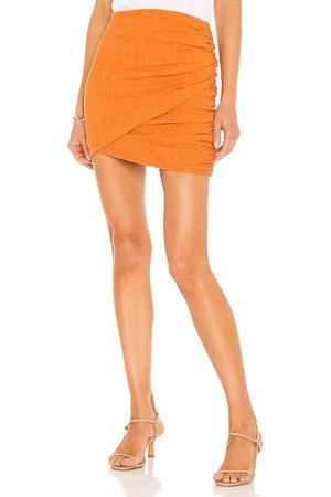 Camila Coelho Minifalda tais en color naranja talla L en - Orange. Talla L (también en XXS, XS, S, M, XL).