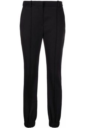 Alexander McQueen Pantalones de vestir con tobillo elástico