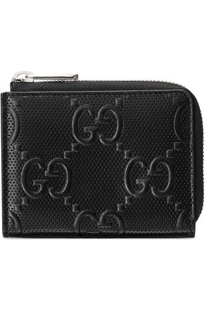 Gucci Cartera compacta con logo GG en relieve