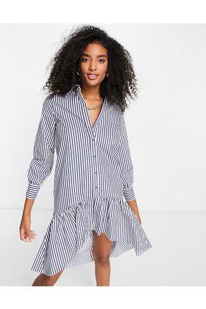 River Island Vestido camisero corto azul a con sobrefalda de -Multicolor